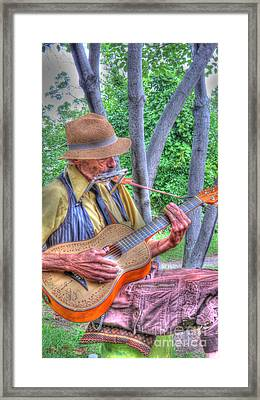 Traveling Troubadour Framed Print by Putterhug  Studio