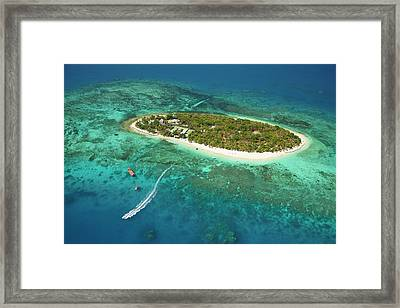 Treasure Island Resort And Boat Framed Print