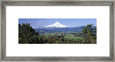 Trees And Farms With A Snowcapped Framed Print by Panoramic Images