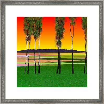Trees Under A Red Sky Framed Print by GuoJun Pan