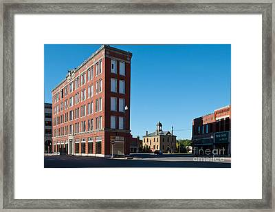 Framed Print featuring the photograph Triangle Building by Lawrence Burry