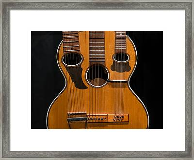 Triple-neck Instrument Framed Print