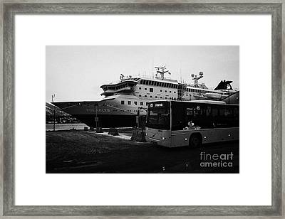 troms public bus and hurtigruten mv polarlys at Tromso harbour troms Norway europe Framed Print by Joe Fox