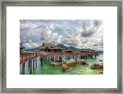 Tropical Home Framed Print by Adrian Evans