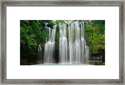 Tropical Waterfall Framed Print by Oscar Gutierrez