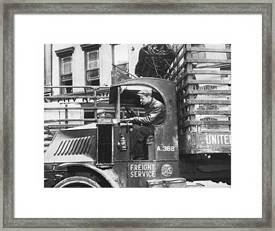 Truck Driver In His Cab Framed Print by Underwood Archives