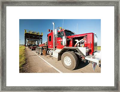 Trucks Haul Load Of Tar Sands Equipment Framed Print by Ashley Cooper