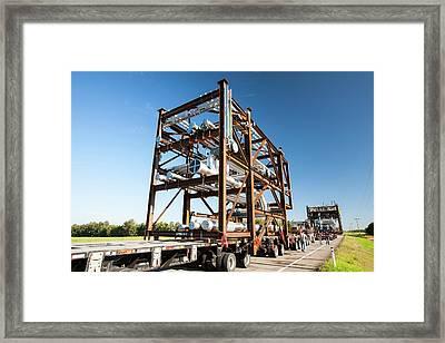 Trucks Haul Tar Sands Equipment Framed Print by Ashley Cooper