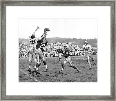 Trying To Catch A Pass Framed Print by Underwood Archives