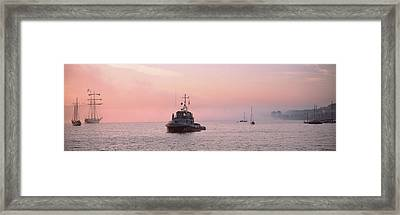Tugboat And Tall Ships In The Ocean Framed Print