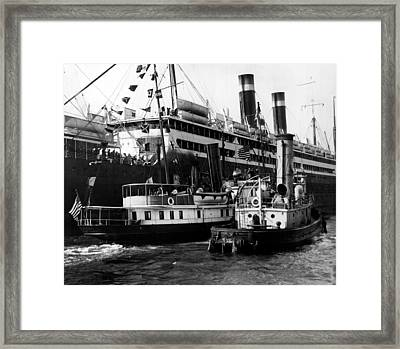 Tugboats Beside Bigger Ship Framed Print by Retro Images Archive