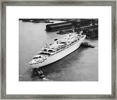Tugs Pushing Ocean Liner Framed Print by Underwood Archives