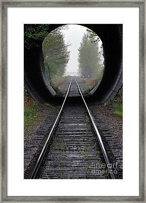 Tunnel Into The Mist  Framed Print