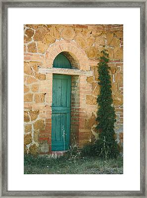 Tuscan Door Framed Print by Clint Brewer