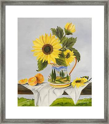 Tuscan Pitcher And Sunflowers Framed Print by Carol Sweetwood