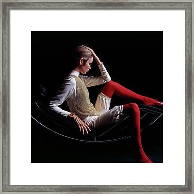 Twiggy Sitting On A Modern Chair Framed Print by Bert Stern