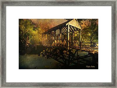 Twilight Bridge Framed Print by Kylie Sabra