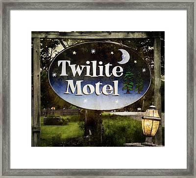 Twilight Motel Framed Print by Joan Carroll