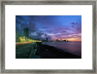 Twilight View Of Young Cubans Sitting Framed Print by Steve Winter