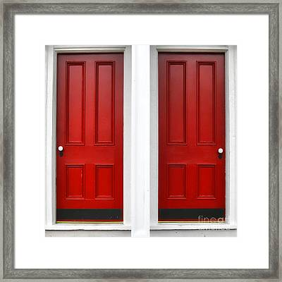 Twin Red Doors Framed Print