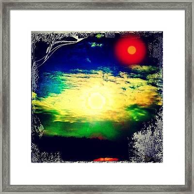 Twin Suns Setting Framed Print