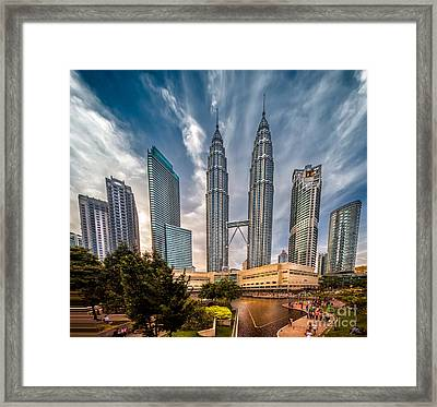 Twin Towers Kl Framed Print by Adrian Evans