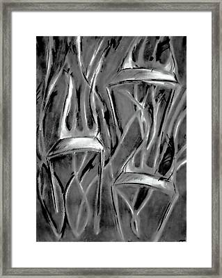 Twisted Chairs Framed Print by John Grace