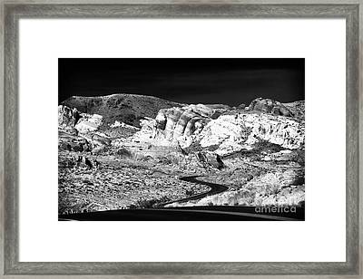 Twisting And Turning Framed Print by John Rizzuto