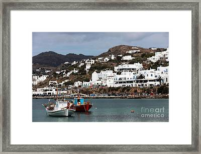 Two Boats In The Mykonos Harbor Framed Print by John Rizzuto