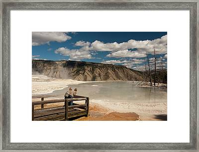 Two Boys Admiring Canary Springs Framed Print by Howie Garber