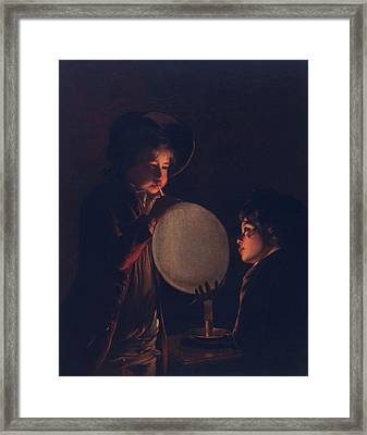 Two Boys By Candlelight, Blowing Framed Print