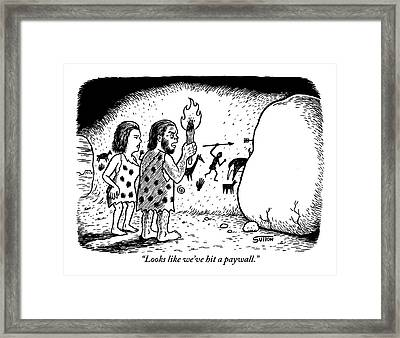Two Cave Dwellers Stand In Front Of A Boulder Framed Print