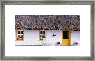 Two Chairs Outside A Cottage, County Framed Print by Panoramic Images