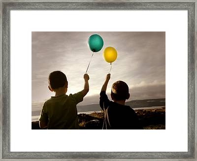 Two Children With Balloons Framed Print by Con Tanasiuk