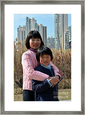 Two Chinese Teen Sisters Hug  And Embrace Shanghai China Framed Print
