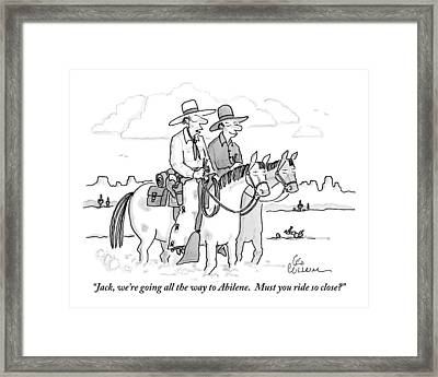 Two Cowboys Ride Horses Side-by-side Framed Print
