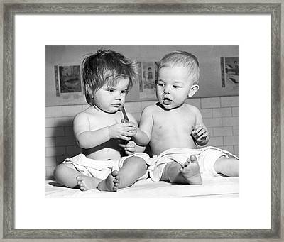 Two Cute Children Sharing Framed Print