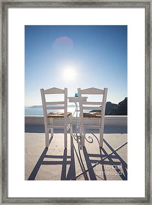 Two Empty Chairs Overlooking Blue Mediterranean Sea In Santorini Framed Print by Matteo Colombo