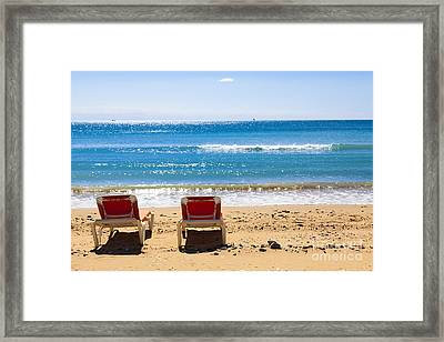 Two Empty Sun Loungers On Beach By Sea Framed Print