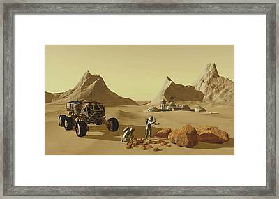 Two Explorers Collect Rock Samples Framed Print by Corey Ford