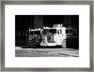 two FDNY fire engines 16 and 7 wait beside crosswalk 34th Street new york city Framed Print