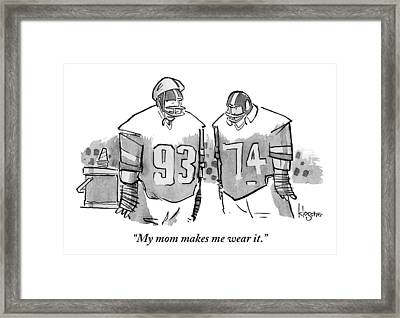 Two Football Players Are Talking To Each Other Framed Print by John  Klossner