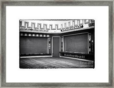 Two Games Framed Print by John Rizzuto