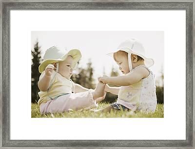 Two Girls Sit Together Framed Print