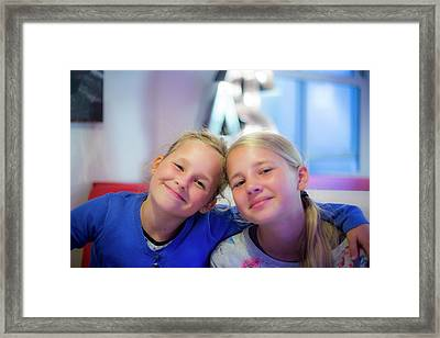 Two Girls Smiling Arms Around Each Other Framed Print