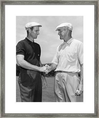 Two Golfers Shake Hands Framed Print by Underwood Archives