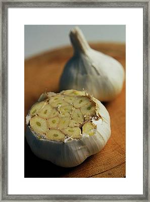 Two Heads Of Garlic Framed Print by Romulo Yanes