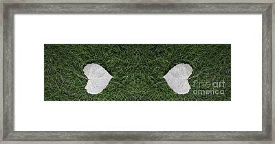 Two Heart Leaves In The Green Grass Framed Print by Linda Matlow