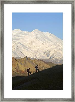 Two Hikers View Mckinley At Grassy Pass Framed Print by Jeff Schultz