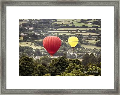 Two Hot Air Baloons Drifting Framed Print